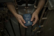 In this Feb. 6, 2017 photo, a detainee holds a Bible inside an overcrowded cell at a police station near Manaus, Brazil. A recent study by think-tank Fundacao Getulio Vargas estimates that 40 percent of Brazilian prisoners have not been convicted. AP Photo/Felipe Dana