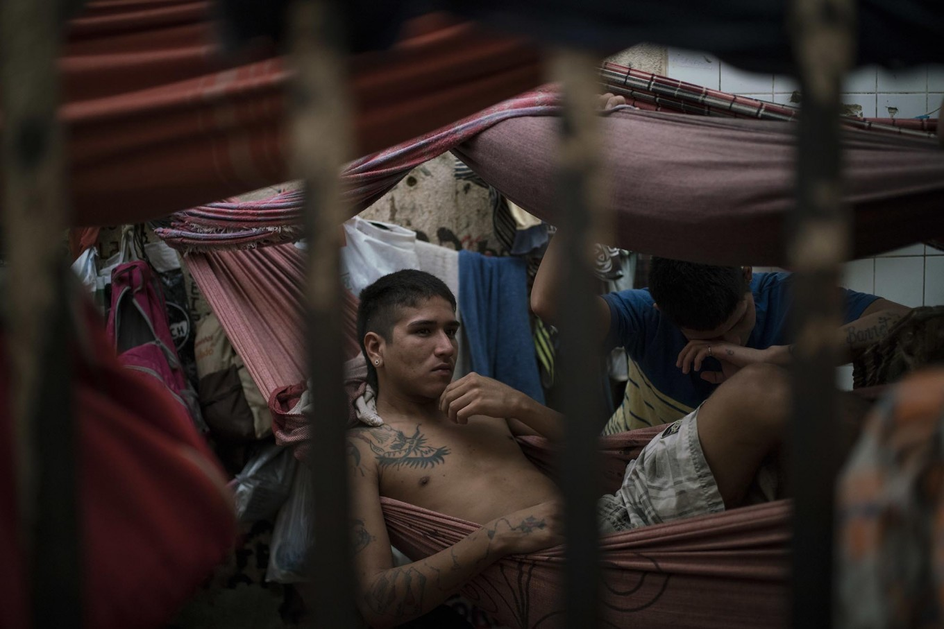In this Feb. 6, 2017 photo, detainees rest in hammocks inside an overcrowded cell at a police station near Manaus, Brazil. All 24 inmates at the station said they were linked to the Family of the North gang, but guards said that could be just a defensive move after a slaughter at the city's main jail, Complexo Penitenciario Anisio Jobim. AP Photo/Felipe Dana