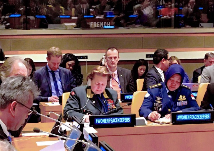 Indonesia's Lt. Col. Ratih Pusparini (right) and Norway's Maj. Gen. Kristin Lund (center) attend a session of the United Nations' Special Committee for Peacekeeping Operations (C-34), in New York last year.