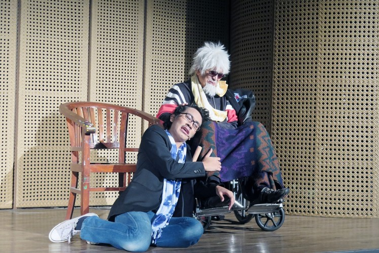 Father and son: Playright Putu Wijaya (right) performs with his son, Taksu Wijaya, in the Oh stage play.