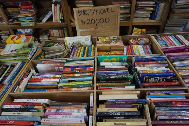 A secondhand book seller at Blok M Square, South Jakarta.