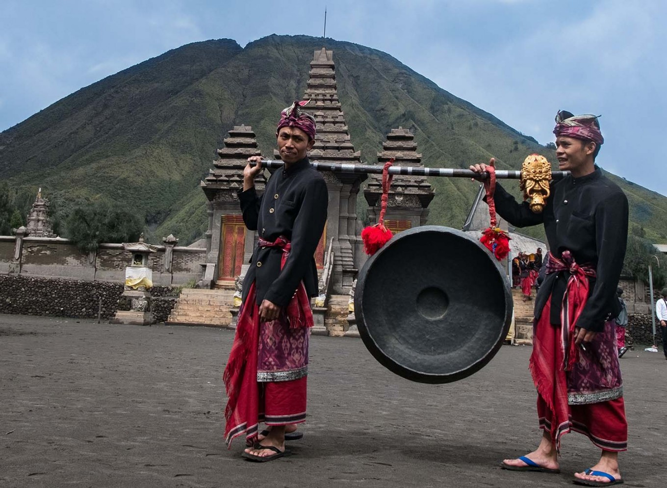 Two men carry a gong for the wedding ceremony at Luhur Poten temple, Mount Bromo. JP/Tarko Sudiarno
