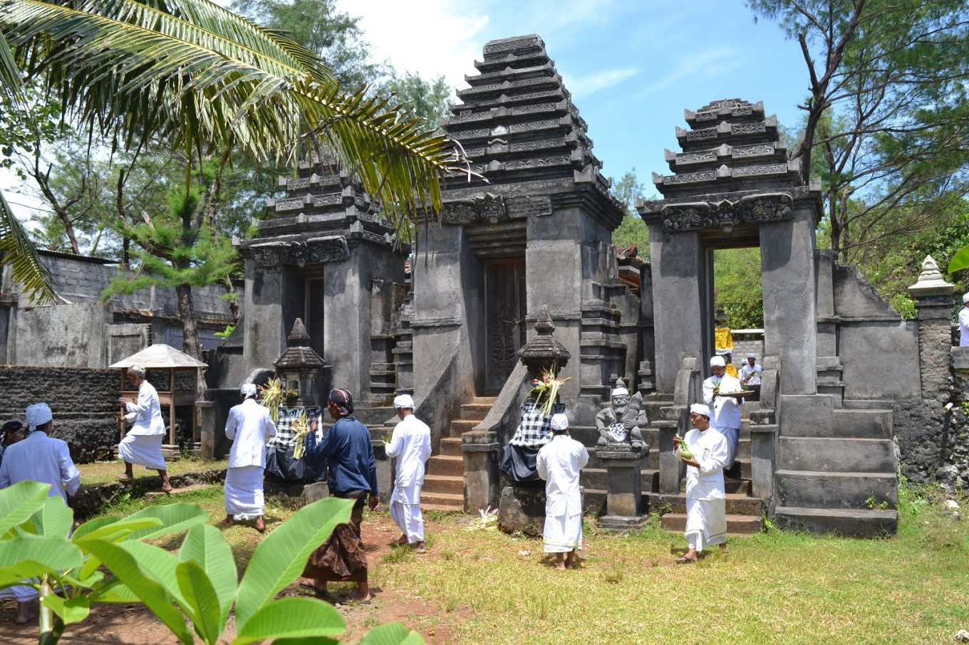 Hindu adherents undertake the ritual of cleaning and purifying sacred objects belonging to Segara Wukir Temple.