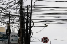 Cable craze: Disorganized cable arrangements affect the capital's landscape and views. JP/ Dhoni Setiawan