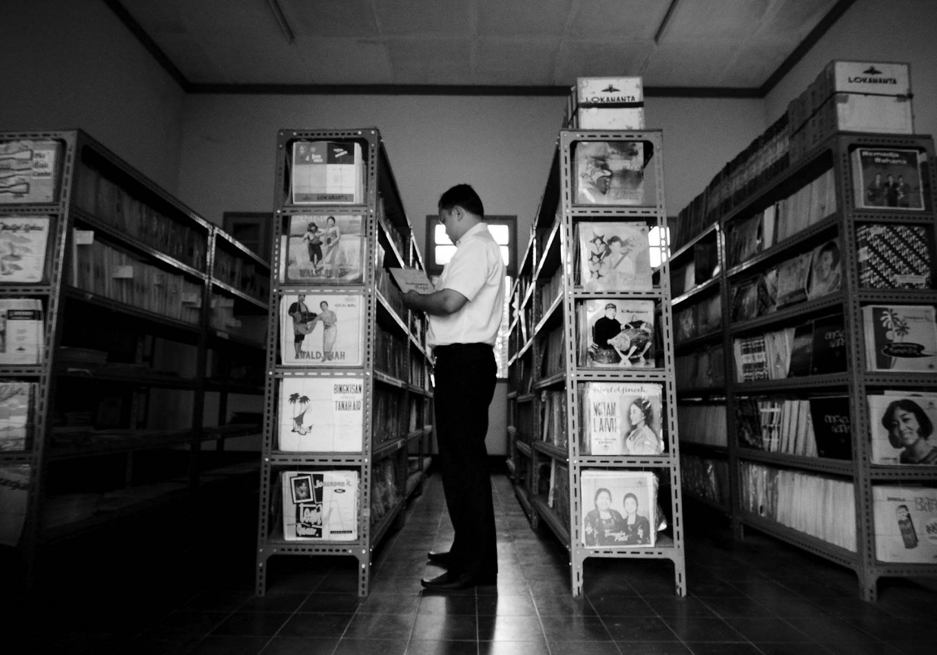 A staff members checks on records shelved in a storage room at Lokananta. JP/Ganug Nugroho Adi