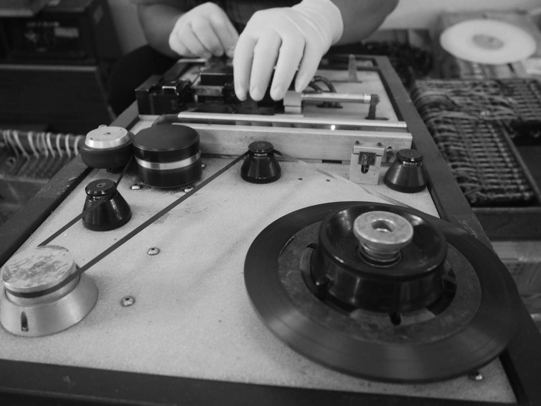 A staff member manually processes a cassette. JP/Ganug Nugroho Adi