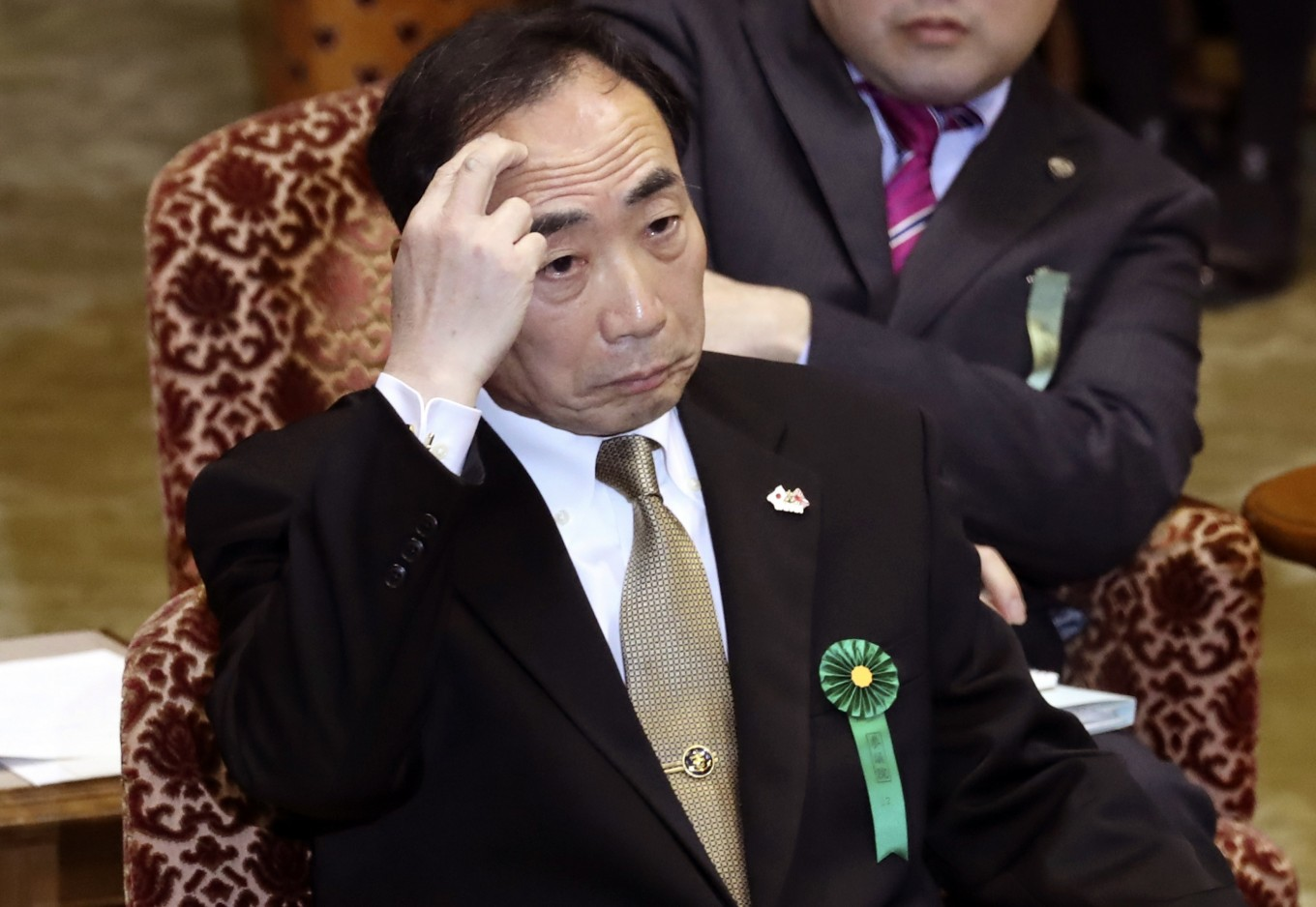 Abe's wife accused of giving envelope of cash in Japan scandal