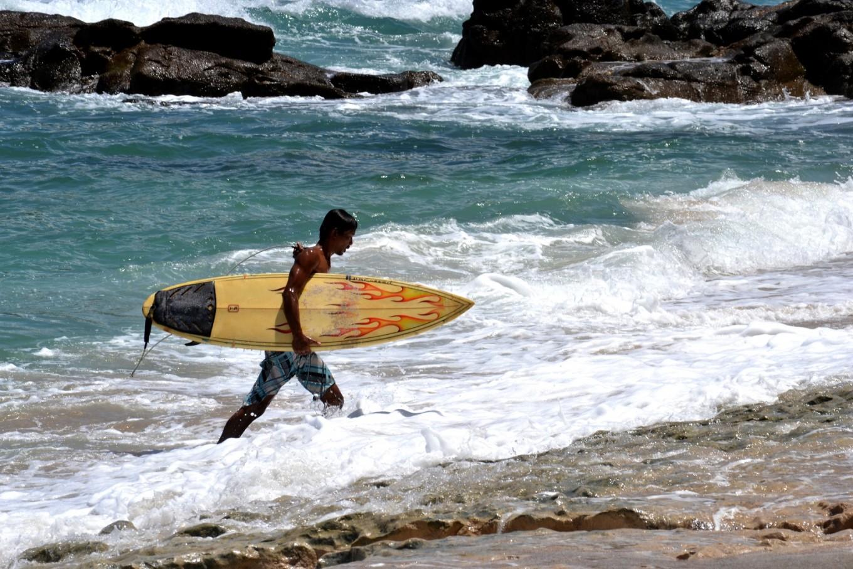 Riding the waves at Wediombo Beach, Yogyakarta