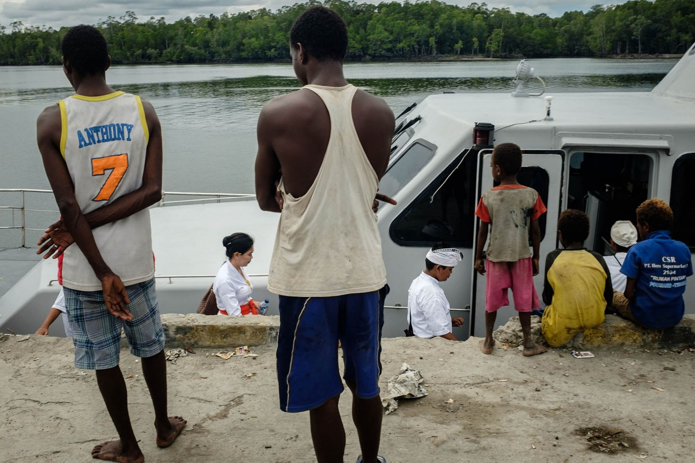 Papuans watch several Balinese Hindus boarding a boat to collect sea water to be used in Melasti rituals. JP/Vembri Waluyas