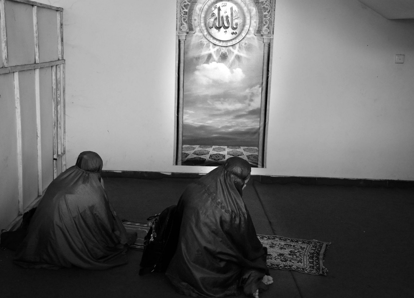Two players pray in between matches during the 2017 Pro Liga in Ken Arok Indoor Stadium in Malang, East Java, on March 18. JP/Aman Rochman