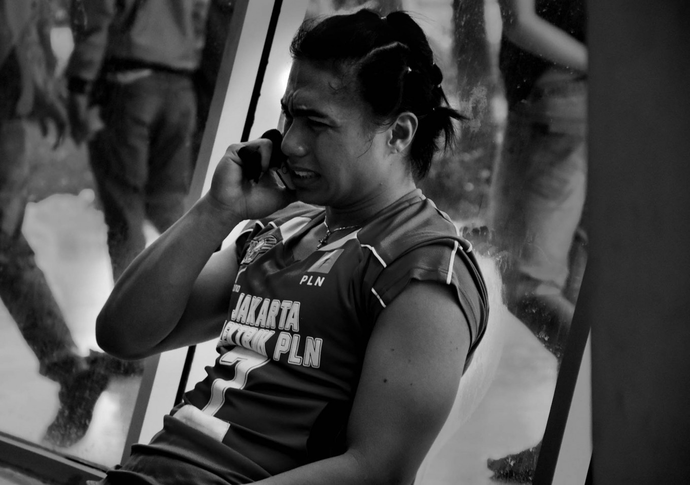 Aprilia Manganang of the Jakarta Elektrik PLN makes a phone call while crying after her team lost on March 18. JP/Aman Rochman