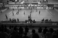 Spectators sit and watch enthusiastically during the second leg of the women's Pro Liga competition at Ken Arok Indoor Stadium in Malang, East Java, on March 18. JP/Aman Rochman