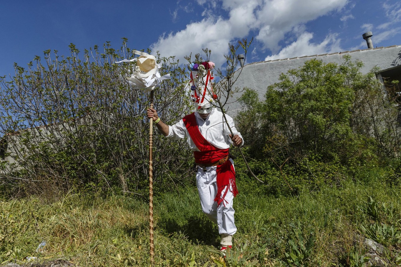 In this April 1, 2017 picture a reveler in a mask from the traditional La Vijanera de Silio carnival runs after picking a branch from a tree during a parade at a gathering of different villages' carnival masks and characters in the small village of Casavieja, Spain, Monday, April 3, 2017. These festivals, held across central and northwestern Spain, most often coincide with festivities celebrating the advent of spring, mixing Carnival and bizarre pagan-like rituals with mock battles between good and evil. AP/Daniel Ochoa de Olza