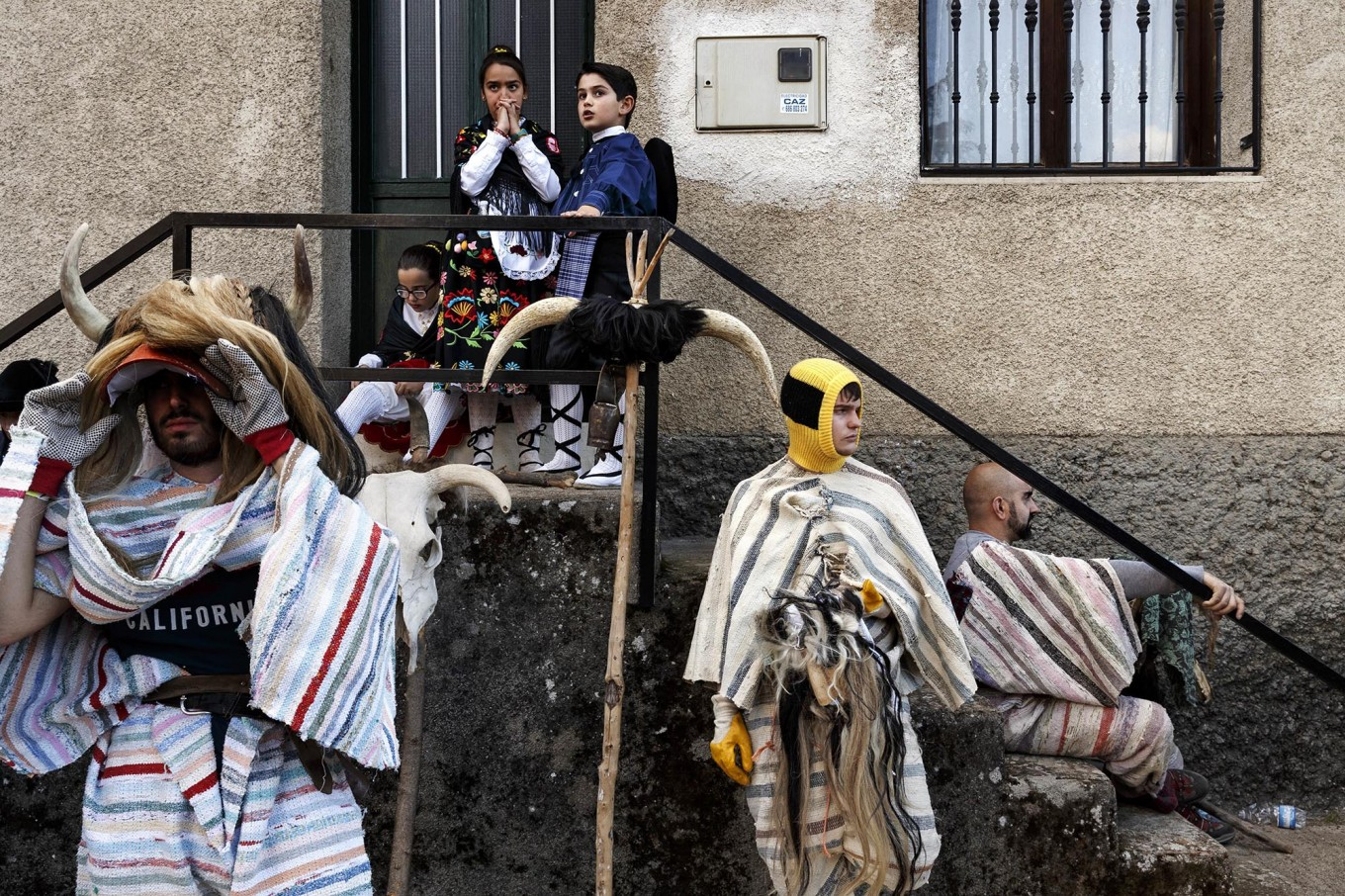 In this April 1, 2017 picture revelers from Navalosa village wearing the traditional 'Cucurrumacho' mask and outfit rest after a parade during a gathering of different villages' carnival masks and characters in the small village of Casavieja, Spain, Monday, April 3, 2017. AP /Daniel Ochoa de Olza