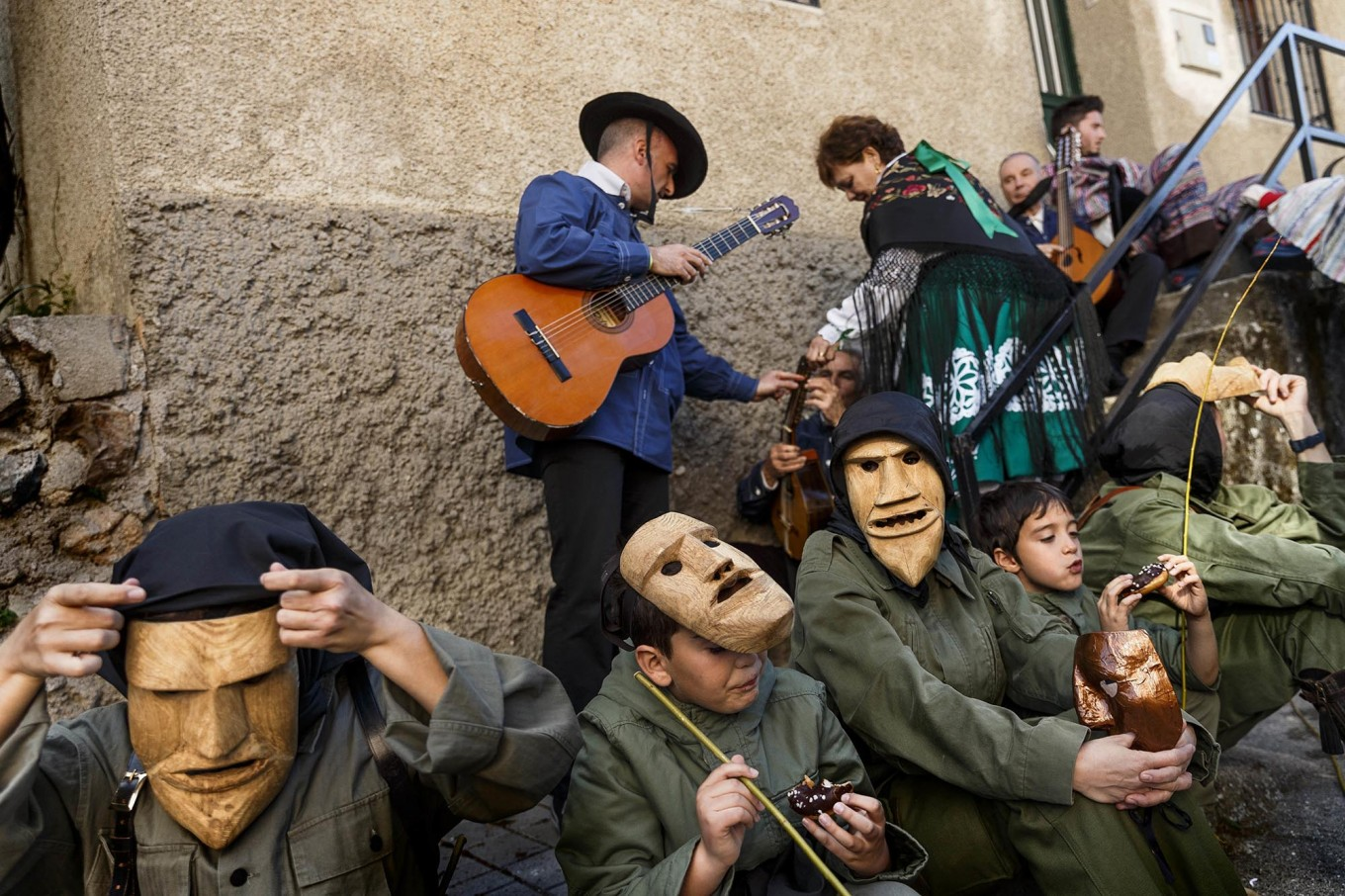 In this April 1, 2017 picture revelers from San Pedro Bernardo village wearing the traditional 'Machurrero' mask and outfit rest and eat after a parade during a gathering of different villages' carnival masks and characters in the small village of Casavieja, Spain, Monday, April 3, 2017. These festivals, held across central and northwestern Spain, most often coincide with festivities celebrating the advent of spring, mixing Carnival and bizarre pagan-like rituals with mock battles between good and evil. AP /Daniel Ochoa de Olza