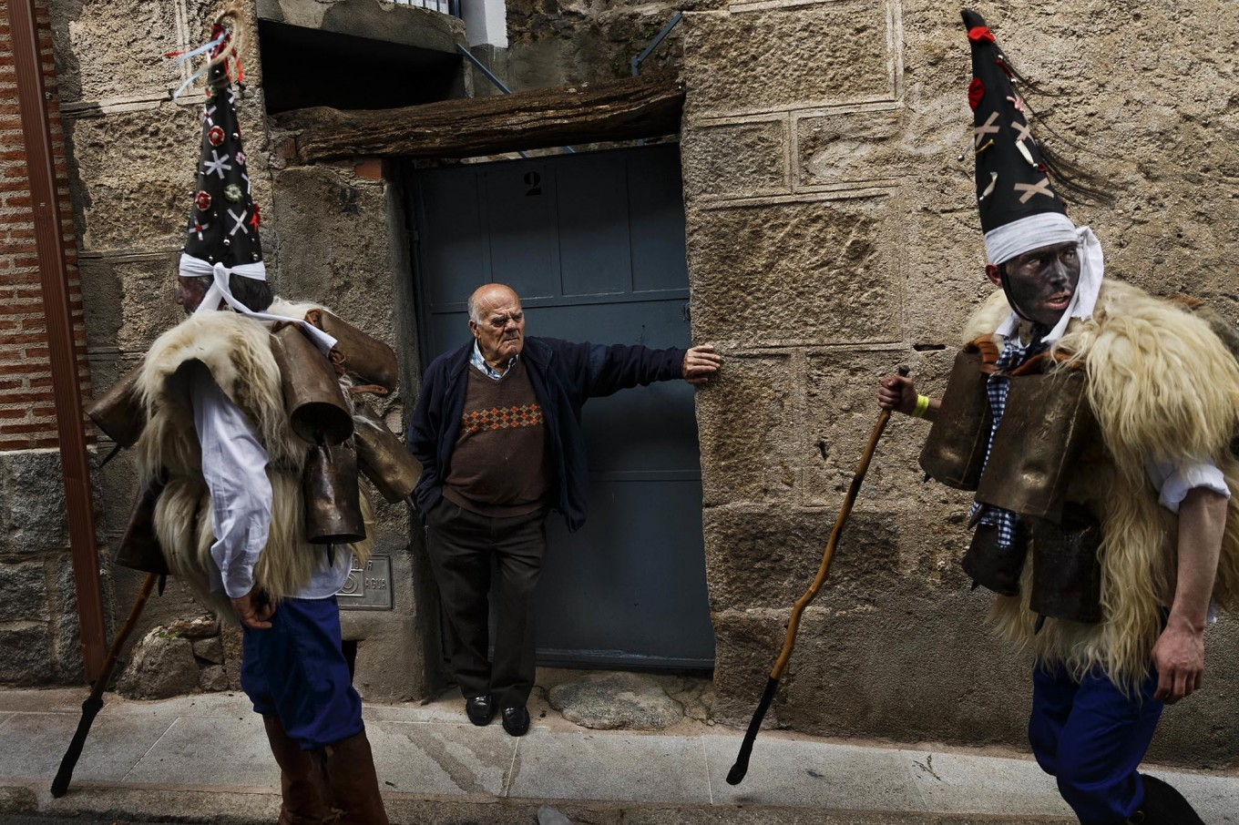 In this April 1, 2017 picture a man representing a wild bear runs through 'Zarramacos' ringing their cowbells in representation of the traditional carnival of La Vijanera de Silio during a gathering of different villages' carnival masks and characters, in Casavieja, Spain, Monday, April 3, 2017. These festivals, held across central and northwestern Spain, most often coincide with festivities celebrating the advent of spring, mixing Carnival and bizarre pagan-like rituals with mock battles between good and evil. AP /Daniel Ochoa de Olza
