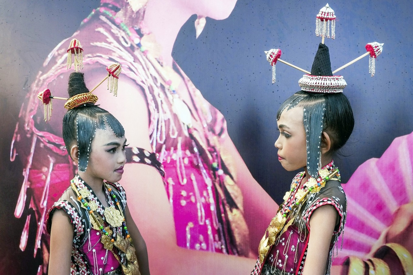 Face to face: Young girls dressed in traditional costumes strikes a pose before the Karia'a ceremony.