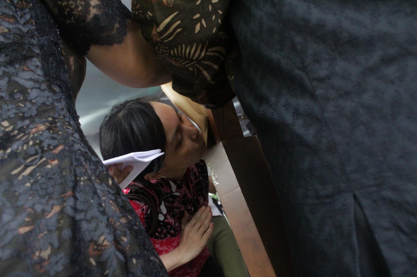 A woman kisses the foot of a crucified Jesus statue on Good Friday in Jakarta Cathedral. The event that commemorates the death of Christ is a part of the Holy Triduum, beginning with Maundy Thursday and ending on Easter Sunday. JP/Bagas Rahadian