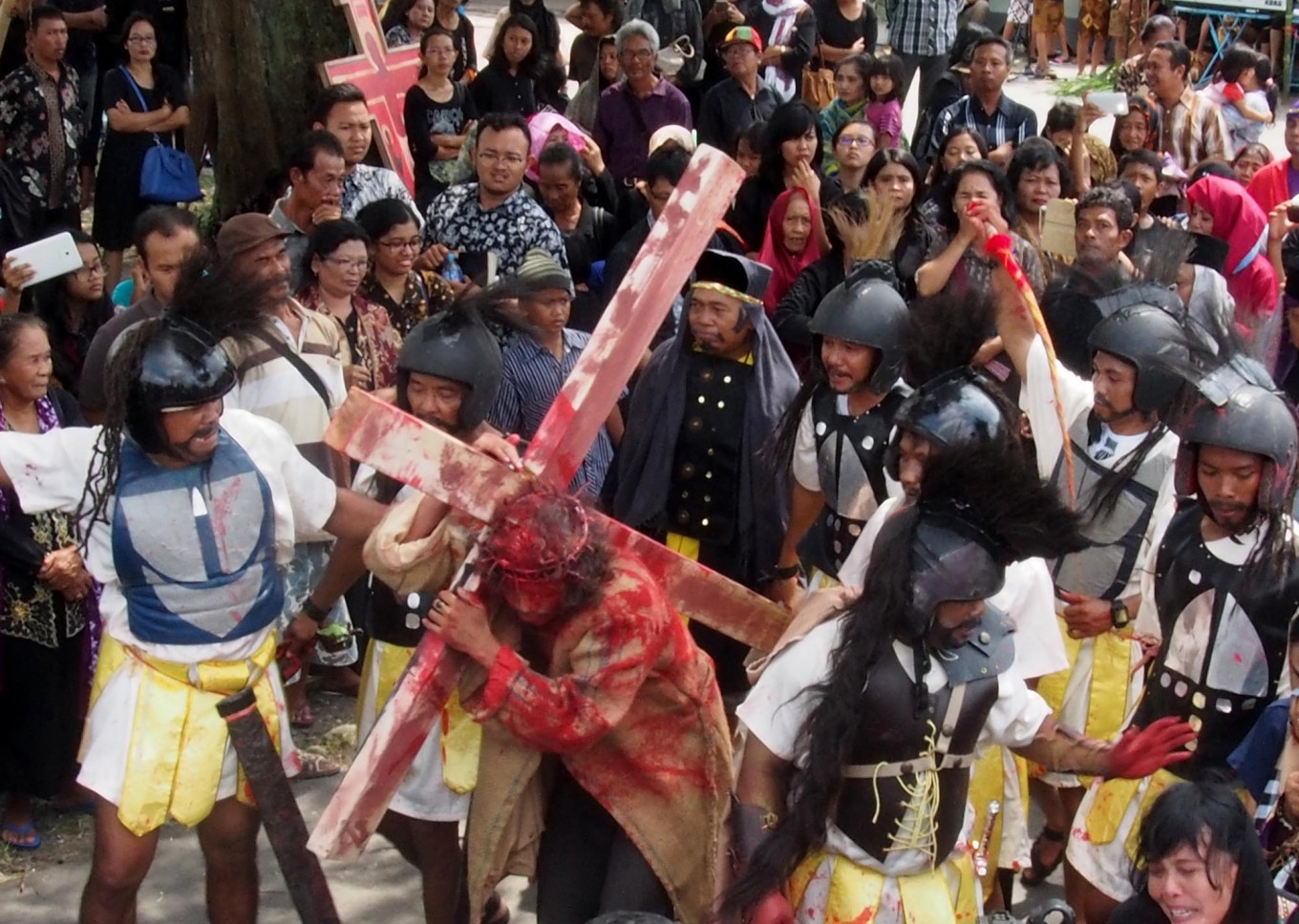 An actor from Ngolodono Church in Karangdowo, Klaten, Central Java, performs the Procession to Calvary, which shows Jesus carrying the cross to the site of his crucifixion.  JP/Ganug Nugroho Adi