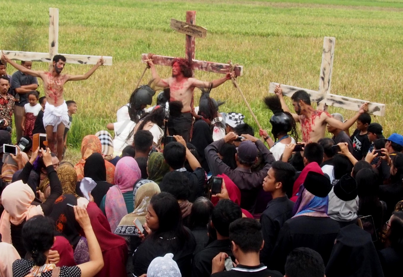 Catholic performers from Ngolodono Church in Karangdowo, Klaten, Central Java, act out the crucifixion of Jesus Christ on Good Friday. JP/Ganug Nugroho Adi