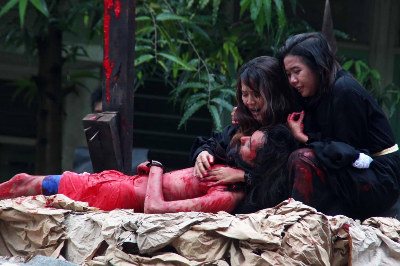 Actors playing the parts of Jesus, the Virgin Mary and Mary Magdalene perform at Santa Theresa church in Bojongsari, Semarang, Central Java. JP/Suherdjoko