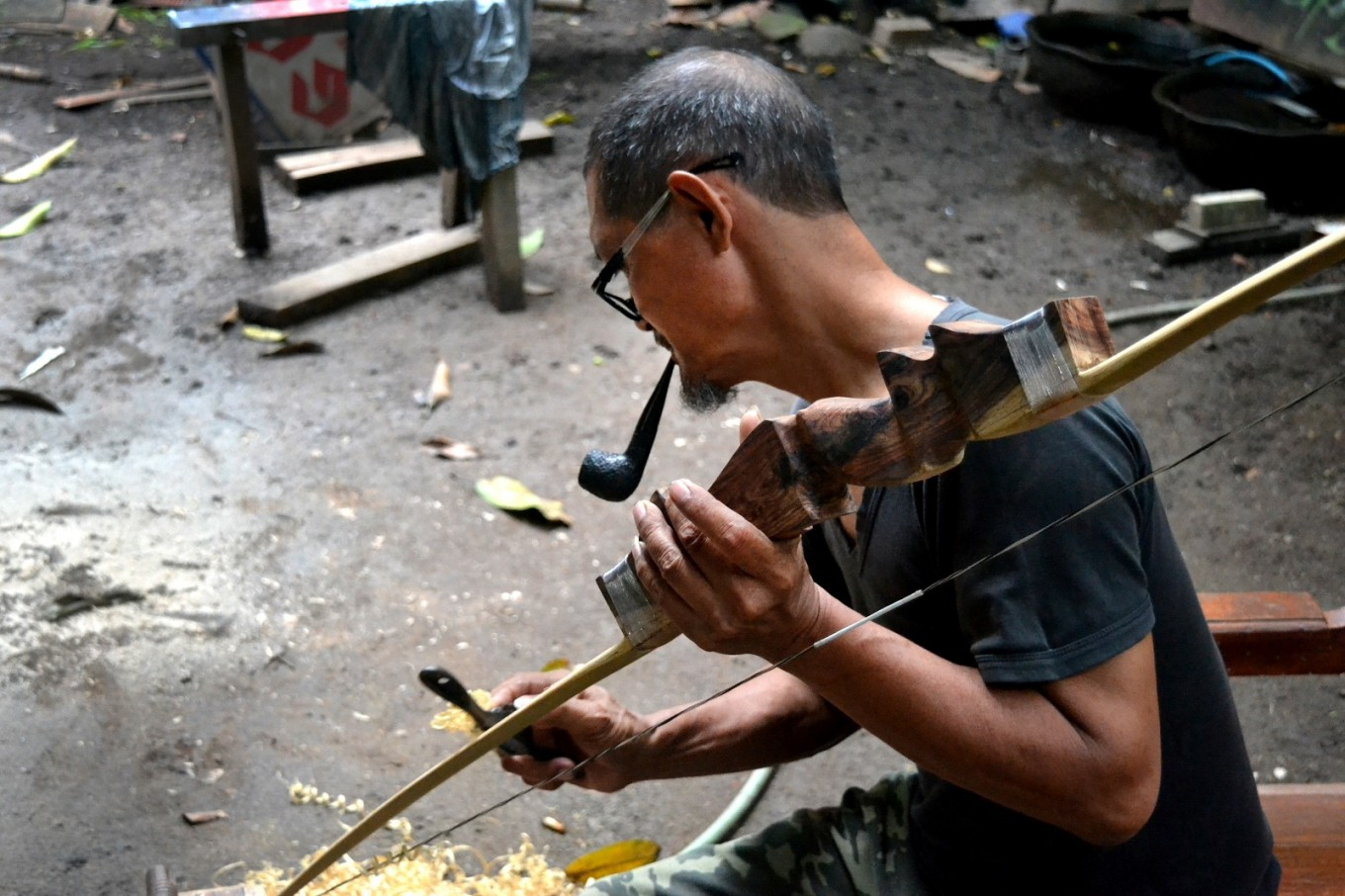 Mbah Popop's passion for traditional archery survives and he continues to practice jemparingan and craft the bows and arrows of the ancient art form.