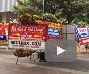 City Hall decorated with wreaths thanking Ahok