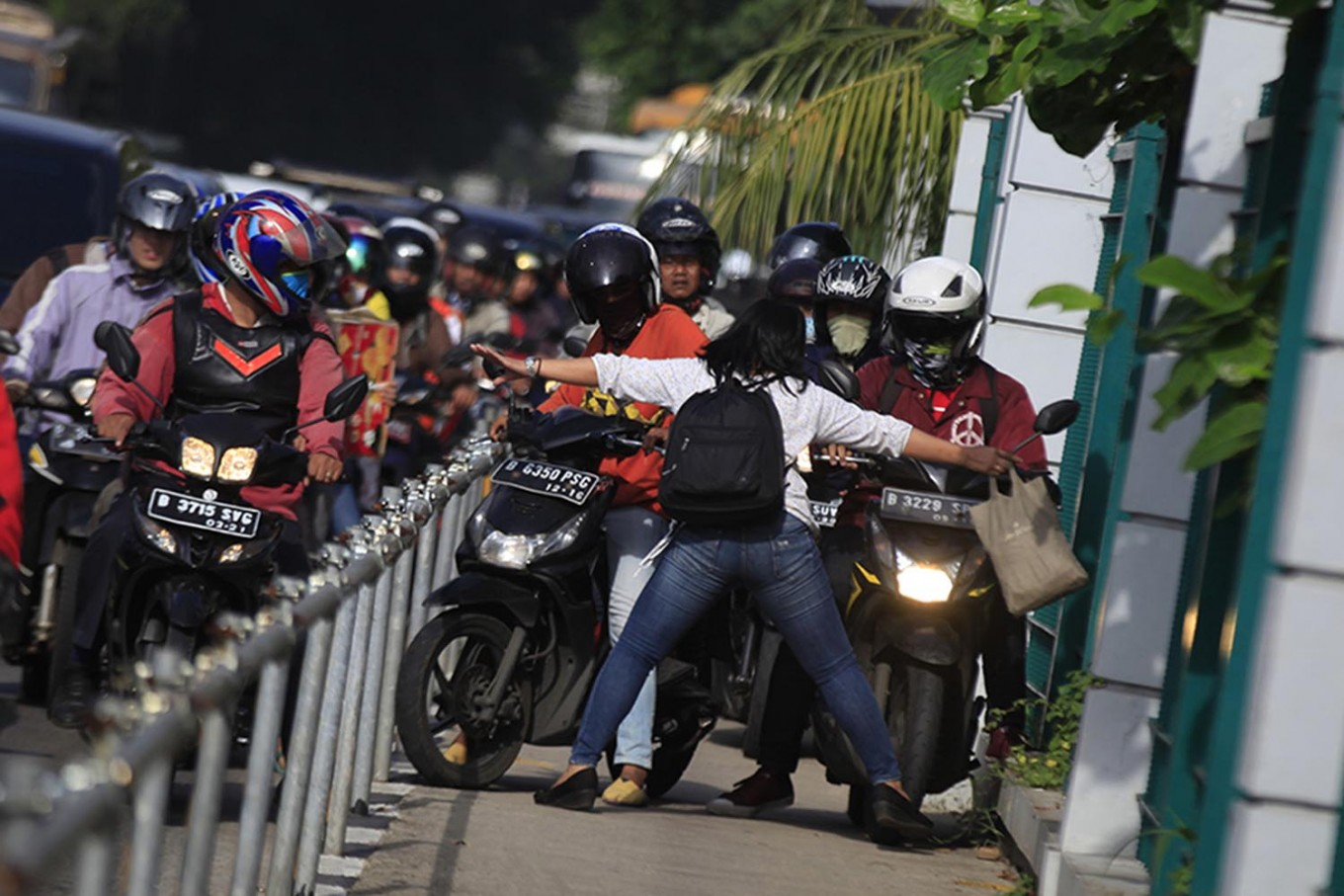 Bold move: Hadang pemotor nakal (Blocking naughty motorcyclists) by Dhoni Setiawan
