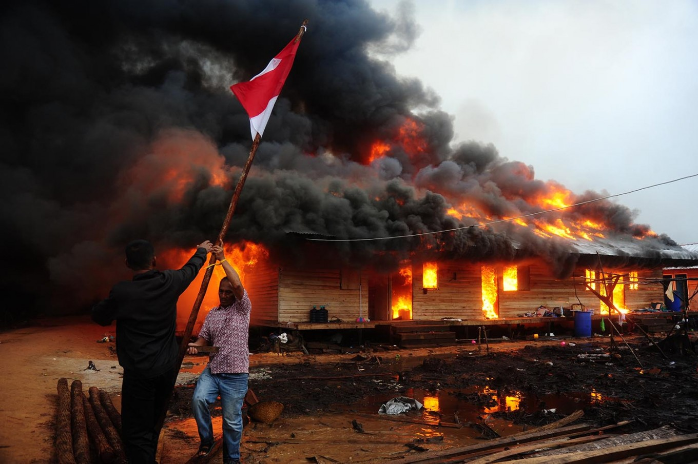 Engulfed by fire: Selamatkan merah putih (Save national flag) by Jessica Helena Wusyang