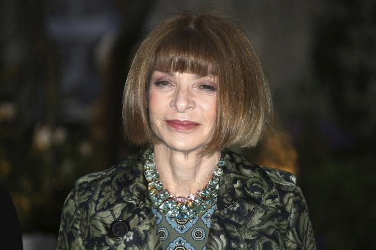 In this Sept. 19, 2016, file photo, Vogue editor Anna Wintour poses for photographers upon arrival at the Burberry Spring/Summer 2017 fashion show at London Fashion Week in London. Wintour is teaming up with Gwyneth Paltrow to take the actress' Goop website to print, magazine publisher Conde Nast announced on April 28, 2017.