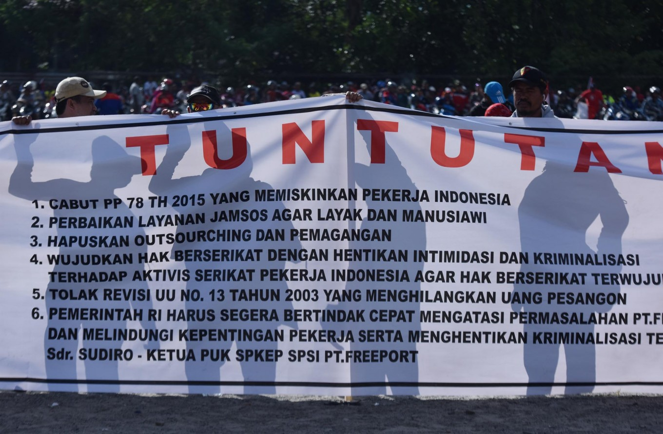 Freeport Indonesia workers to extend strike for a month: union