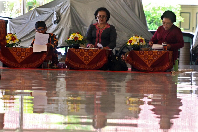 A panel of three judges listen and assess a performance. JP/Aditya Sagita