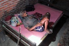 Mbah Jo Gotho lies on his bed while listening to his radio at his house in Sragen, Central Java, in this Sept. 8, 2016, file photo. Even though he was already 146 years old, he could still hear clearly. JP/Magnus Hendratmo