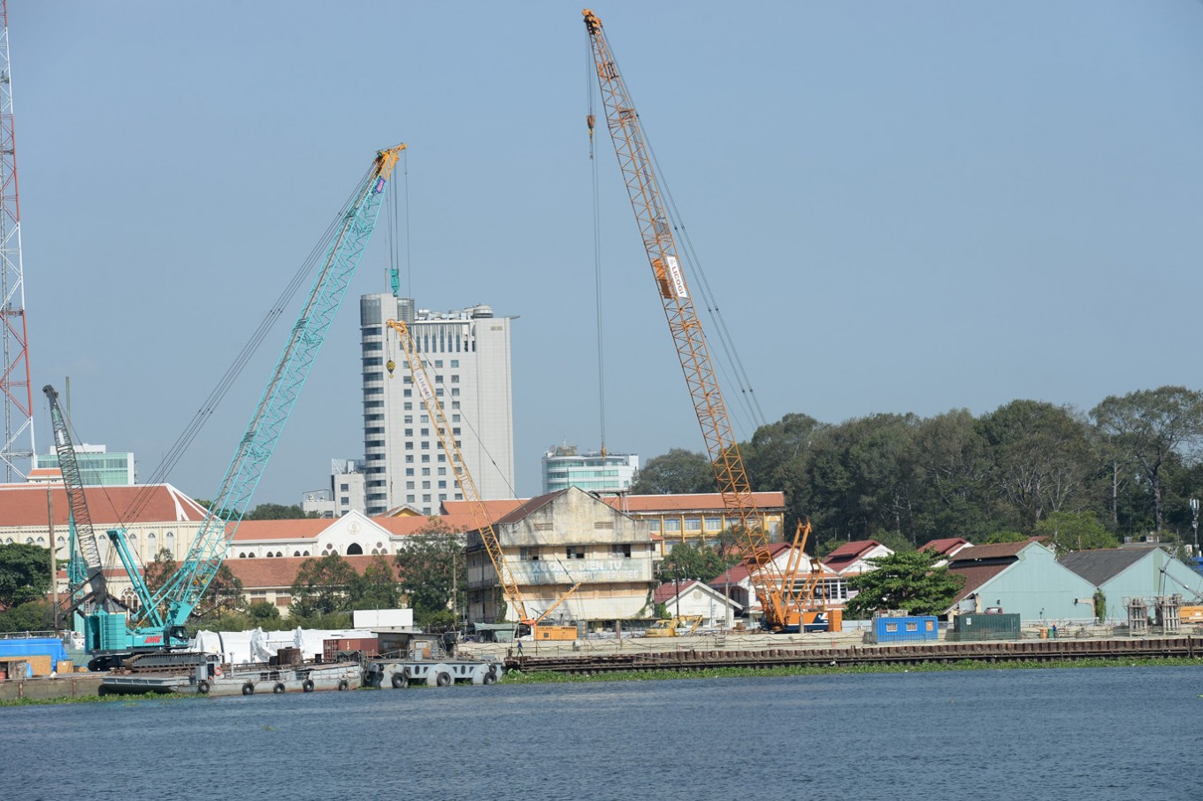 "This picture taken on February 21, 2017 shows the Ba Son ship yard which dated back to French colonial-era being demolished for the construction of new highrise buildings on the bank of Saigon river in Ho Chi Minh City (former Saigon). They formed the charming backdrop to Graham Greene's sin-filled city in ""The Quiet American"" but Saigon's colonial buildings are fast disappearing, sparking fears Vietnam's biggest city is becoming another generic Asian megalopolis."
