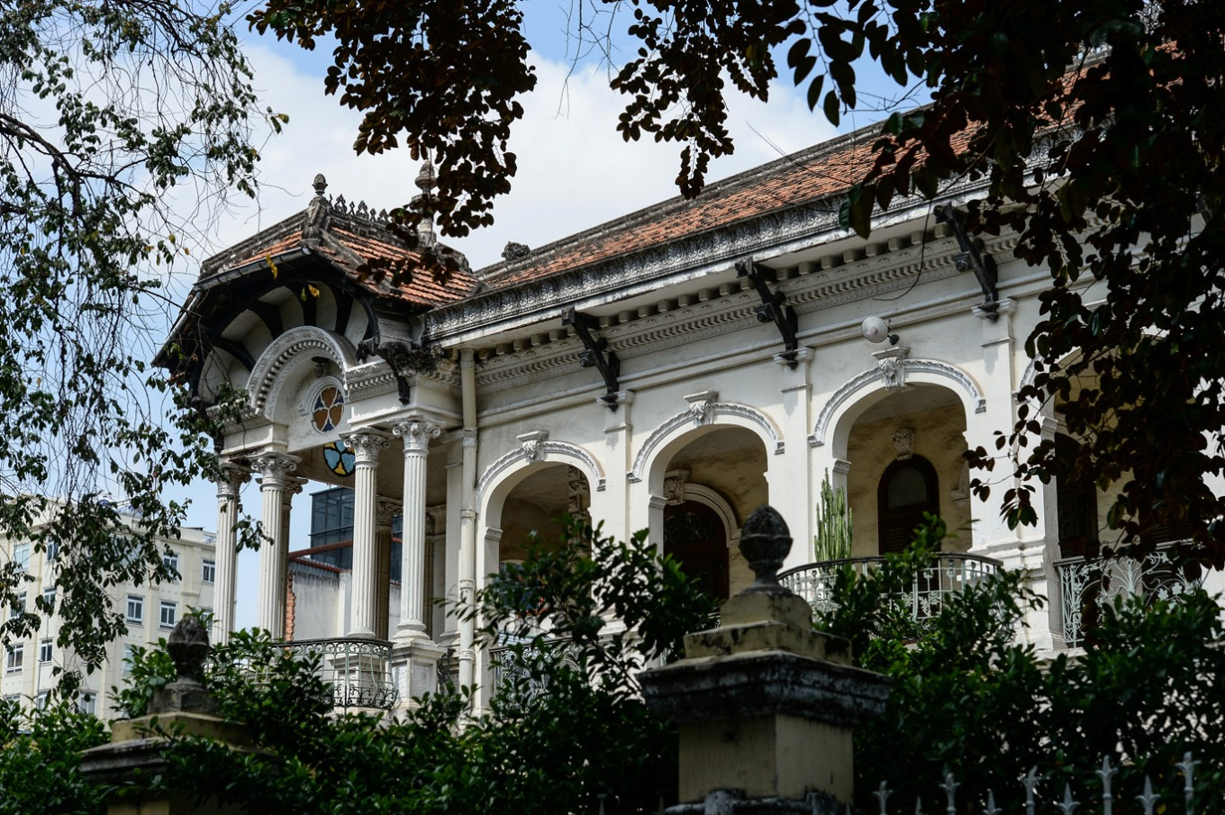 "This picture taken on February 21, 2017 shows a part of one of the most beautiful French-colonial era villas which was reportedly offered for 35 million dollars in Ho Chi Minh City (former Saigon). They formed the charming backdrop to Graham Greene's sin-filled city in ""The Quiet American"" but Saigon's colonial buildings are fast disappearing, sparking fears Vietnam's biggest city is becoming another generic Asian megalopolis."