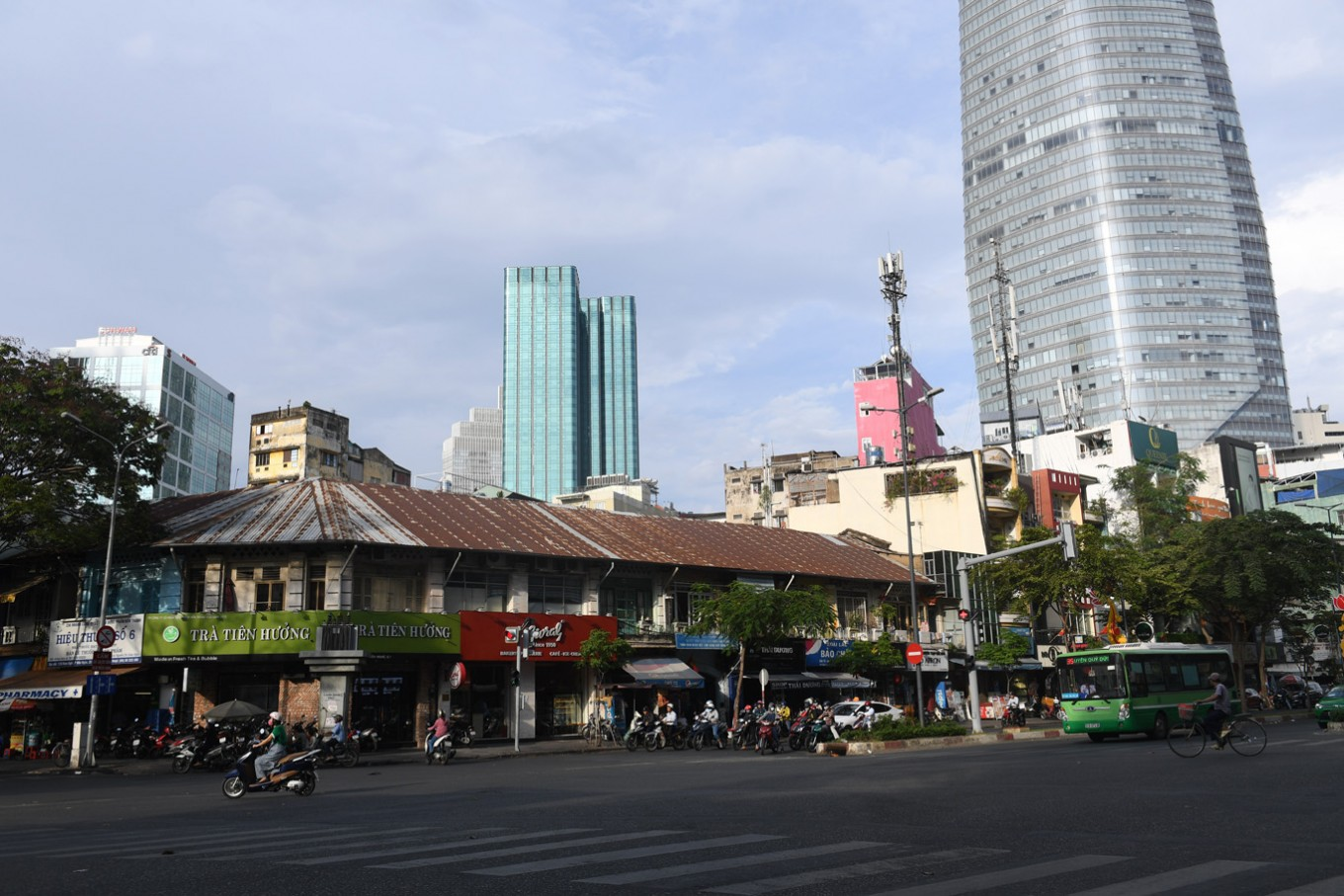 "This picture taken on February 21, 2017 shows the Becamex tower (R) looming over the nearby French-colonial era residential houses in downtown Ho Chi Minh City (former Saigon). They formed the charming backdrop to Graham Greene's sin-filled city in ""The Quiet American"" but Saigon's colonial buildings are fast disappearing, sparking fears Vietnam's biggest city is becoming another generic Asian megalopolis."