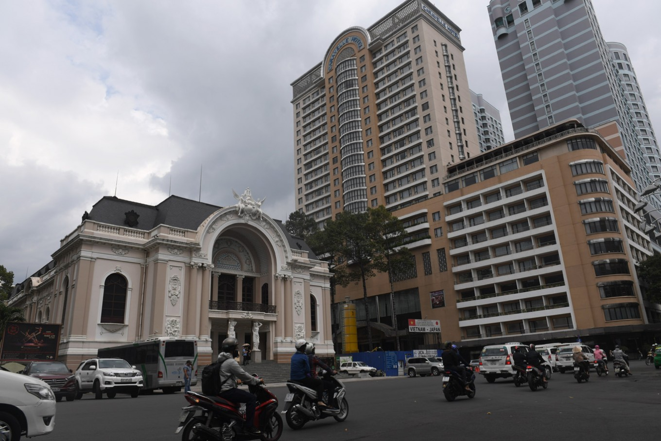 "This picture taken on February 21, 2017 shows new high hotels looming over the French-style opera house in downtown Ho Chi Minh City (former Saigon). They formed the charming backdrop to Graham Greene's sin-filled city in ""The Quiet American"" but Saigon's colonial buildings are fast disappearing, sparking fears Vietnam's biggest city is becoming another generic Asian megalopolis."