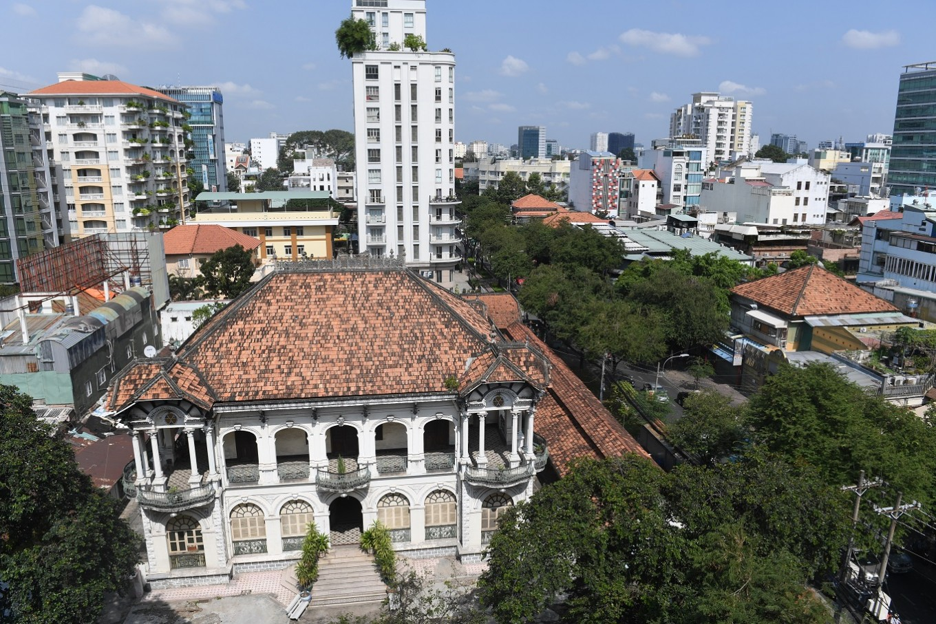 "This picture taken on February 21, 2017 shows the aerial view of one of the most beautiful French-colonial era villas which was reportedly offered for 35 million dollars in Ho Chi Minh City (former Saigon). They formed the charming backdrop to Graham Greene's sin-filled city in ""The Quiet American"" but Saigon's colonial buildings are fast disappearing, sparking fears Vietnam's biggest city is becoming another generic Asian megalopolis."