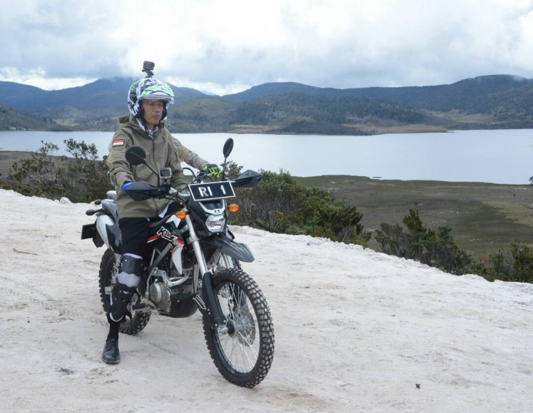 "President Joko ""Jokowi"" Widodo gets ready to inspect the progress of trans-Papua road project by trail motorbike in Wamena on May 10."