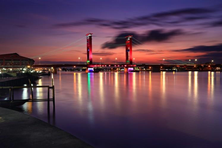 Ampera Bridge at night. The bridge is an iconic landmark in Palembang.
