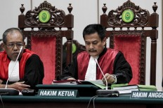 "North Jakarta District Court chief judge Dwiarso Budi Santiarto reads out a guilty verdict against incumbent Jakarta Givernor Basuki ""Ahok"" Tjahaja Purnama and sentences him to two years' imprisonment for blasphemy. JP/Kurniawan Mas'ud/Pool"