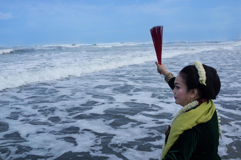 A woman prays at Parang Kusumo Beach, Yogyakarta, during the Labuhan ceremony on April 27, 2017. JP/Tarko Sudiarno