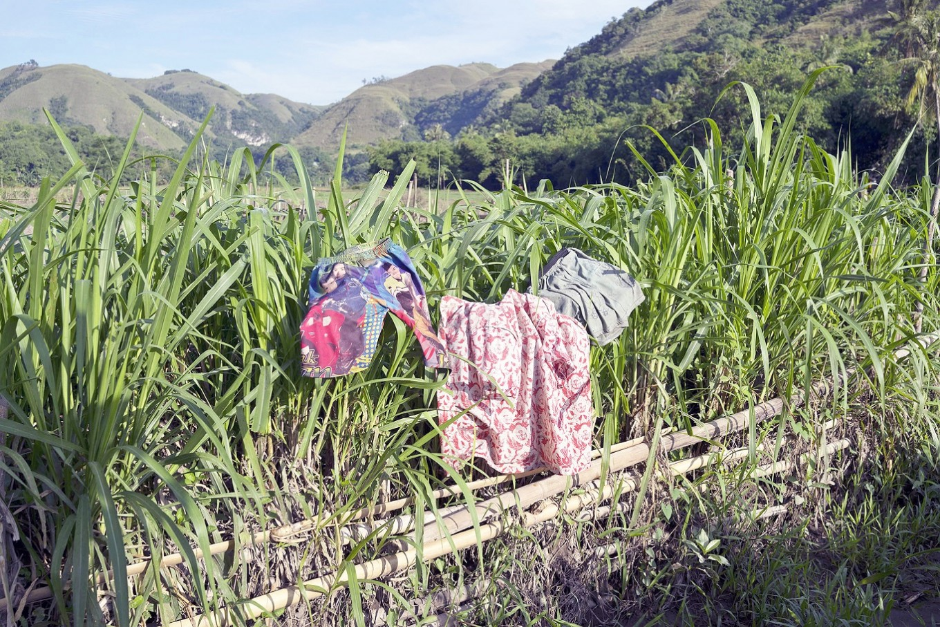 Out to dry: Damp clothes worn by the children are dried under the sun.