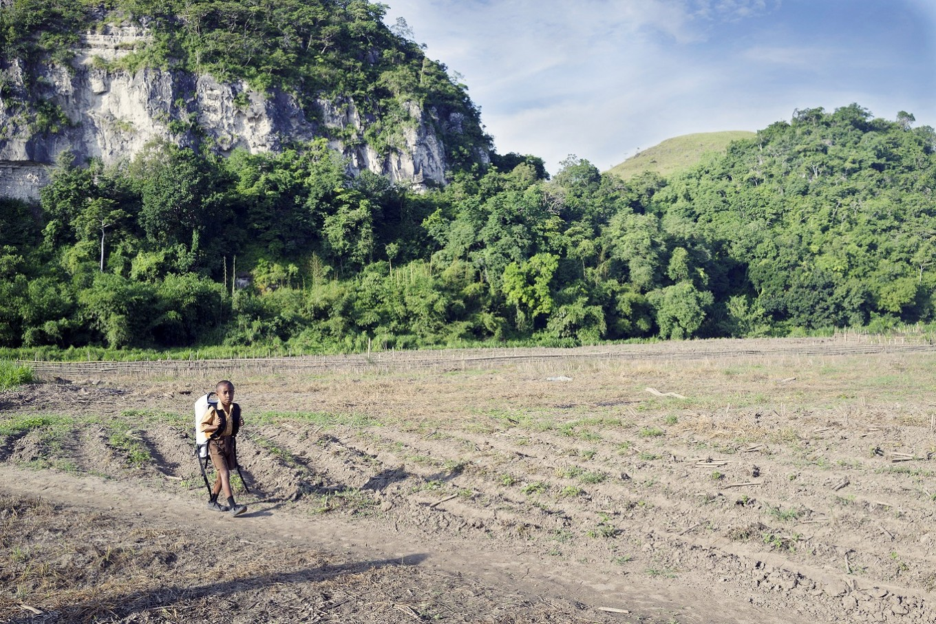 Long walk to freedom: After the river, the children are now ready for their final challenge; a 90-minute walk across mountainous terrain to their school.