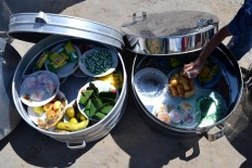 Various fruits and other food inside tenong (containers made of aluminum or bamboo). JP/Stefanus Ajie