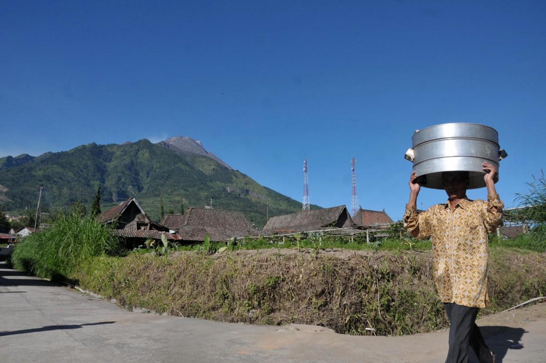 A villager walks across the road to join the Nyadran tradition at Cepogo, Boyolali regency, Central Java. JP/Ganug Nugroho Adi