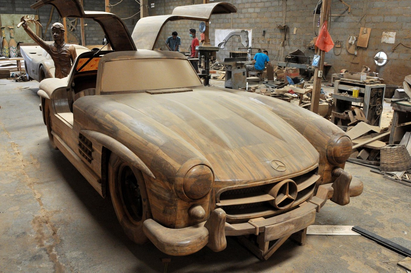 A replica of a Mercedes-Benz 300 SL gull-wing takes center stage in the Tetap Jaya Art workshop in Mojosongo village, Boyolali regency, Central Java. JP/Magnus Hendratmo