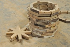 A stack of wheel parts is seen at the workshop. A teakwood replica can weigh up to 900 kilograms. JP/Magnus Hendratmo