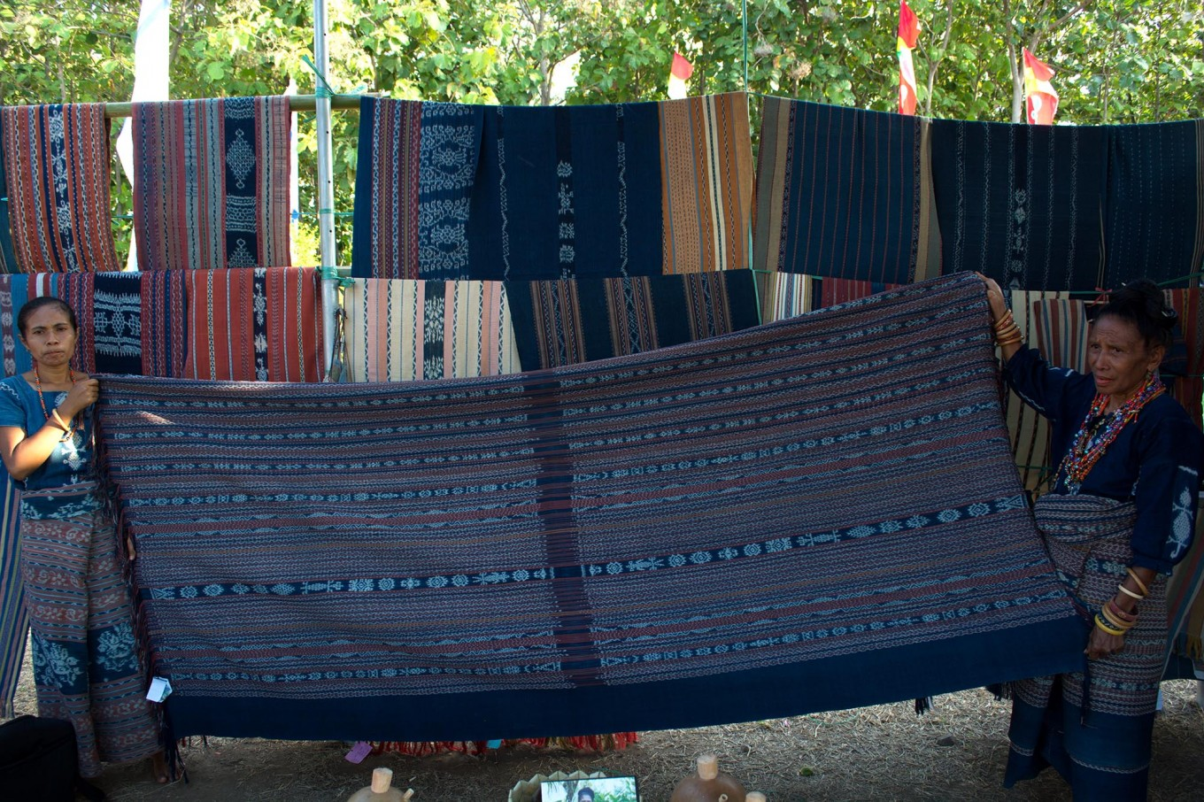 Sikka women show sacred traditional ikat cloths displayed during the exhibition. JP/Intan Tanjung