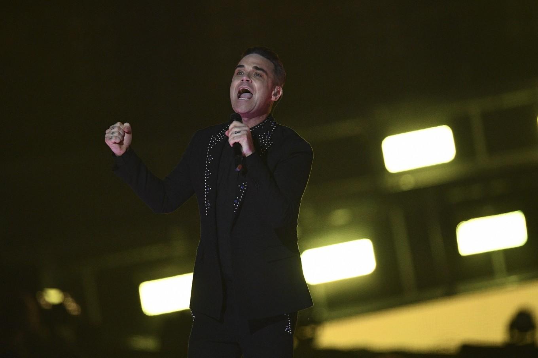 Take that, Elvis! Robbie Williams equals UK album chart record